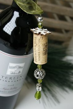 more wine bottle bling i made this year.  cork, beads & snowflakes. you could also add a tag w/ sentiments....super easy.