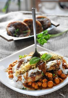 aloo chaat recipe Aloo tikki is a potato cutlet or croquette made with boiled potatoes and spices. It is served with chickpea curry.