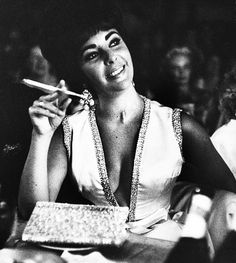 """""""Elizabeth Taylor attends husband Eddie Fisher's opening show at the Desert Inn, 1961. Photographed by Don Cravens."""""""