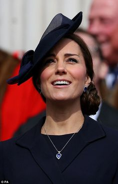 Kate watches as a military flypast of aircraft used in the campaign...