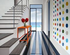 I would love a colorful polka dot wall in my home. Weekend project perhaps?