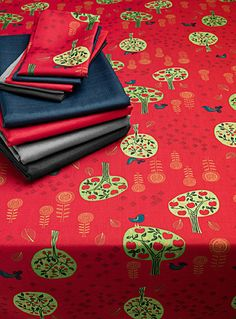 Designed in our studios exclusively for Simons Maison     Cute, naive motifs in intense colours on a pure fashion bright red background. Superior quality 100% polyester weave requires no ironing. Machine washable/dryable.  Napkins and kitchen accessories also available.