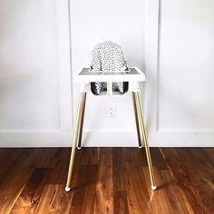 Ikea highchair UPGRADE! Spray paint your legs gold and get a cute cushion cover and placemat from @yeahbabygoods! Pictured her