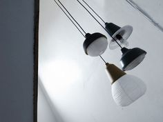 The New Old Light by KIMU, the Taiwanese design trio made up of Lin YiHsien, Shih HsiaoChun and Yeh TingWei, is two lights in one. The fixture was recently featured in the 2013 IMM Cologne show, which showcases emerging furniture design talent.