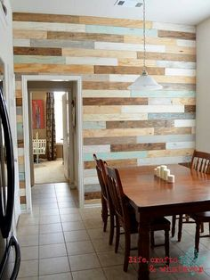 Love this wall made of old pallet boards