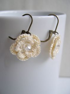 These delicate and elegant ivory earrings will add a chic touch to any outfit. These earrings are very soft and light to wear. I crocheted these earrings with care and love.  Flower only : 3/4 inch/2cm diameter (1 inch/3cm long with copper leverback) (1 3/4 inches/4.5cm long with platinium p...