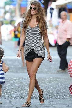 Simple striped tee - black denim shorties & a chic pair of sandals . Bianca Brandolini