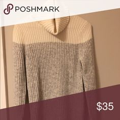 White and Grey Colorblock Turtleneck A cozy turtleneck perfect for the cold winter months. White and shades of grey with small slits in the sleeves. Pair it with jeans for a casual day or dress it up for a winter dinner! Perfect condition, never worn. Banana Republic Sweaters Cowl & Turtlenecks
