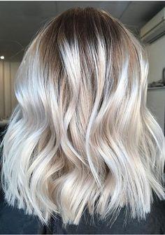 Fresh blonde hair with soft dark roots 2017-2018.