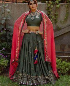 olive mirror work ghaghra choli with hot pink dupatta Blouse Designs High Neck, Tunic Designs, Choli Designs, Lehenga Designs, Garba Dress, Navratri Dress, Choli Dress, Chaniya Choli For Navratri, Indian Wedding Outfits
