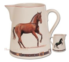 Chantilly Equestrian Pitcher. Nice size pitcher perfect for water, ice tea or cold adult beverage. Ecru glaze hand-decorated with classic dressage horses. Two different images on front and back. Accented with a red trim on top and handle, bottom features bridle work with buckles.    Made in France.  Pitcher  holds approx. 9 cups.