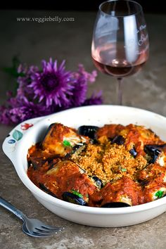 Eggplant Rollatini Stuffed with Couscous and Pine Nuts. (bake eggplant slices instead of frying - works perfectly)