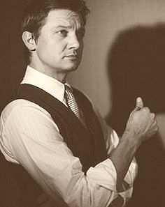 Jeremy Renner. oh can he sing! And then- THEN I saw a collage of him in his classy clothes ... swoon.