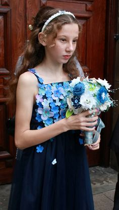 It's all about the blues... A lovely flowergirl in the attired in the blue hues of the day... http://www.thebowdonrooms.co.uk/the-blues-comes-to-bowdon/