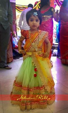 Baby in a colourful half saree