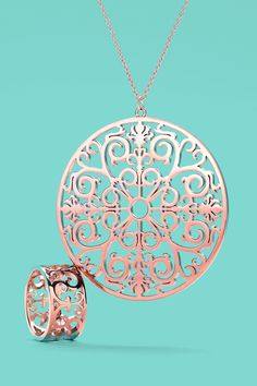 Tiffany Enchant® wide ring and round pendant in RUBEDO® metal. #TiffanyPinterest