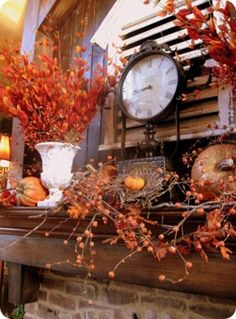 Fall Mantle Decor.   love the old shutter/vent  behind the clock too