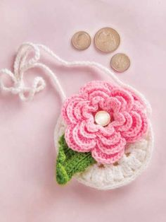 Girl's Flower Purse Crochet Pattern Download from e-PatternsCentral.com -- Little girls are sure to love this darling mini purse that's the ideal size for holding ice-cream money or other small treasures.