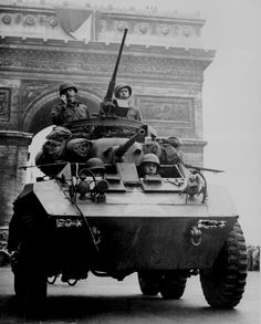 """An """"Greyhound"""" armored scout car of the US Army passes under the Arc de Triomphe after the liberation of Paris in August History Online, World History, World War Ii, Ww2 History, Paris In August, August 25, Liberation Of Paris, Rare Historical Photos, Armored Vehicles"""