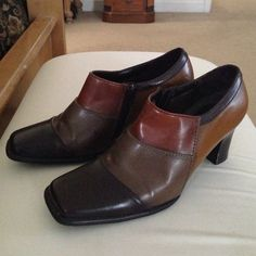 "GORGEOUS TRI-COLOR SHOE BOOTIES These high heel shoe booties are three earth tones of brown. They have sturdy comfortable  3"" heels and cushioned insoles. Zipper openings. Were worn a couple of times. Excellent condition. Highlights Shoes"