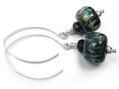 Designed and made by Indigo Silver. Stunning handmade boro glass beads in all shades of blue, with Swarovski crystals to tone. Handmade Sterling Silver, Sterling Silver Jewelry, Glass Earrings, Glass Beads, Ocean Deep, Absolutely Gorgeous, Shades Of Blue, Swarovski Crystals, Indigo