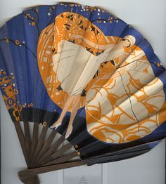 Paper hand fan from the 1920's. The back of the fan reads:  Compliment's of Antonio's, 30 Central Avenue, Panama. French Dresses and Hats, Real Spanish Shawls, English Luggage, Paris Novelties