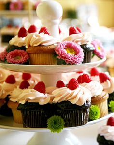 fruit cupcakes with yummy frosting and real strawberry on top,.
