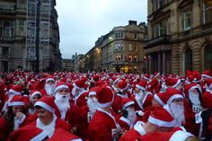 Day 9: 3500 Santas running  Photo Credit: (T.E. Howe)  Location: George Square, Glasgow  More at: http://www.glasgowcityofscience.com/about-us/our-demonstrator-projects/177-12-days-of-science-at-christmas