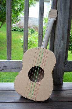 ikat bag: Cardboard Guitar. Paper towel tube, cereal box?
