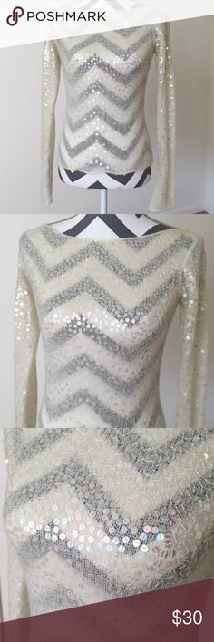 Laundry Shelli Segal ivory sequin sweater Sz. M This gorgeous sweater is very unique. It has sequins all over. More at the top then less at the bottom. It's an ivory color and made of 45% acrylic, 40% nylon, 15% mohair. Very good condition, however after close inspection I did find a very small, faint spot on the end of the sleeve. I've pictured it close up for your reference. It's barely noticeable. Otherwise a stunning sweater! Laundry By Shelli Segal Sweaters
