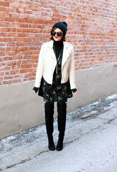 Jessica Quirk wears a modern white leather moto jacket with a black vintage dress and over the knee boots on her blog What I Wore.