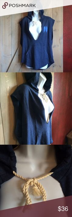 🌸NEVER WORN! VS sleeveless hoodie Never worn. Small but would fit a medium as well. Front pouch pocket, hood with draw string. Big sleeve openings, (open down sides)So soft!! 60% cotton 40% polyester. Navy blue with light blue wing design on front. Victoria's Secret Tops Sweatshirts & Hoodies