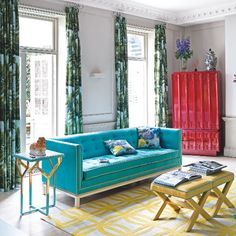 Bright living room | Bold colour | Tropical curtains | Pattern | Yellow | Red | Blue | Livingetc