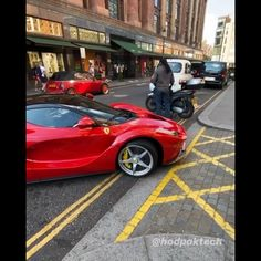 Red Lamborghini pulling up
