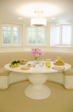 lovely breakfast nook, love the round banquette & round table! (something tells me that round is way more expensive-L)