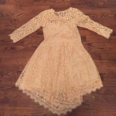 Free People peach lace dress SZ 4 Adorable lace edge dress in peach slip. 3/4 length sleeve. Excellent condition Free People Dresses Mini