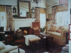 I photographed this living room from the November 2006 issue of Cottage Living. (Oh, Cottage Living, why did you go away?) I saved this issue because I love this room. It's neutral but warm and cozy. I love the window treatments.