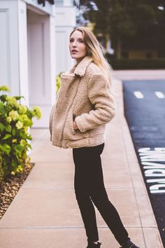 styling a teddy bear jacket as the best outerwear option for winter with a striped top and black skinny jeans // Leslie Musser one brass fox