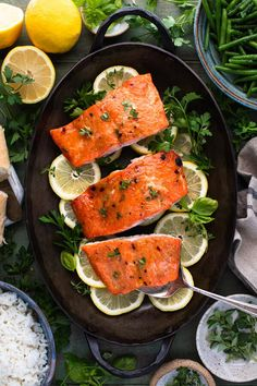 This 4-ingredient roasted salmon recipe will soon become a weeknight staple in your family's meal rotation! With a simple brown sugar Dijon mustard glaze, the fish develops a crisp exterior and a moist, buttery inside. Garnish each fillet with lemon wedges and fresh herbs for a restaurant-quality dinner in just 15 minutes! There are a variety of ways in which to cook salmon -- from grilling to pan-searing, poaching or baking in foil. The method that we choose typically depends on a variety…