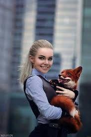 Image result for girl holding fox