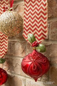 Hang ornaments from lengths of festive burlap ribbon. Then accent them with wint Hang ornaments from lengths of festive burlap ribbon. Then accent them with winter leaves and berries clipped from seasonal floral picks. Source by HobbyLobby Gold Christmas Decorations, Christmas Tree Themes, Noel Christmas, Christmas Projects, Winter Christmas, Holiday Crafts, Christmas Ornaments, Holiday Decor, Elegant Christmas
