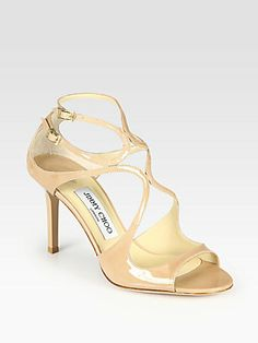 """Jimmy Choo Ivette Strappy Patent Leather Sandals    From the 24:7 Collection. Adjustable, architectural straps in lustrous patent leather accompany a lacquered heel.  Stacked cork wedge, 3½"""" (90mm)  Patent leather upper  Leather lining and sole  Padded insole  Made in Italy"""