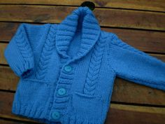 cute hand knitted blue baby cardigan with cable design newborn