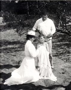 Alexei getting his hair cut, with a governess and Derevenko, around 1910.
