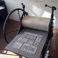 A traditional etching press with 13 drypoint printing plates
