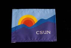 The California State University, Northridge (CSUN) rainbow flag was designed by CSUN alumnus Michael O'Meara,  winner of the 20th Anniversary Flag Design Contest in 1978. According to the artist, the flag incorporated two characteristics associated with the San Fernando Valley, the surrounding mountains and the sunshine. This flag was found in the University's 25th Anniversary time capsule, opened as part of the University's 50th Anniversary celebrations. CSUN University Digital Archives.
