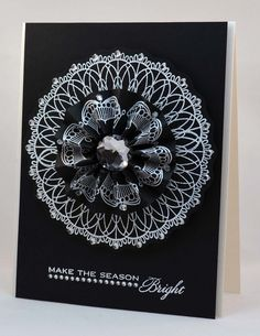 Rosette was made using a strip from WMS's Dainty Doilies 2 set.  The curves of the stamp created a beautiful flower petal effect.