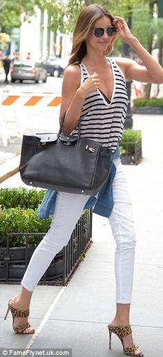 Summer chic: The mother-of-one was also wearing a pair of white skinny jeans and a plunging striped blouse    10      1