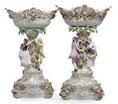 TWO MEISSEN PORCELAIN FLOWER-ENCRUSTED FIGURAL CENTERPIECES AND ...
