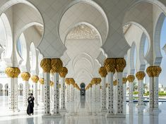 Woman and Mosque Image, Abu Dhabi, United Arab Emirates | National Geographic Photo of the Day